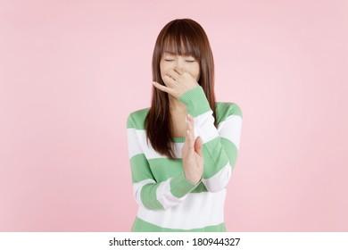 Japanese woman pinching her nose