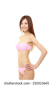 Japanese woman posing in a pink bikini