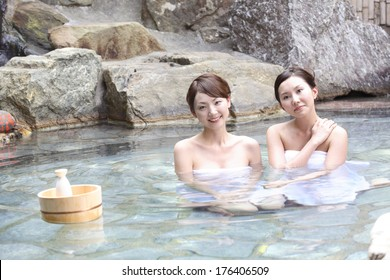 Japanese woman relaxing in a hot spring