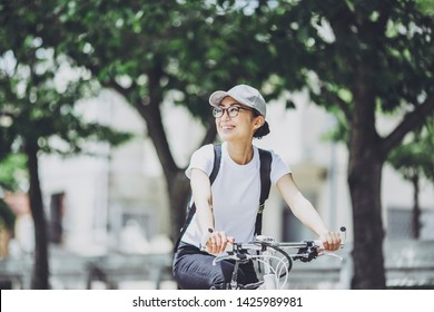 Japanese woman riding a bicycle