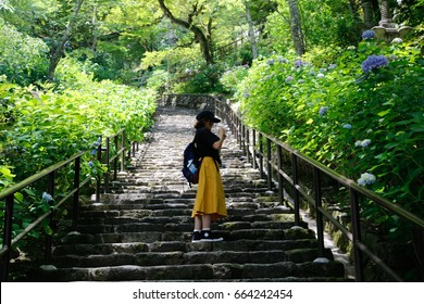 japanese woman stairs to the green garden