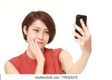 Japanese woman takes a selfie