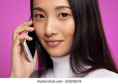 Japanese woman talking on the phone