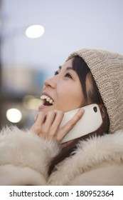 Japanese woman talking on a smart phone