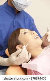 Japanese woman undergoing treatment with Japanese men dentist