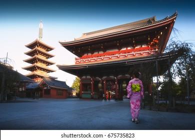 Japanese woman walking to pagoda, Tokyo Japan