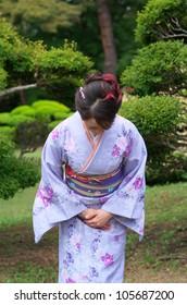 Japanese woman wearing Kimono at Japanese garden