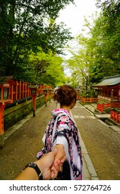 "Japanese woman wearing kimono holding her lover's hand and walking trhough the japanese shrine Japanese Test Translate as ""Shrine of Kyoto"""