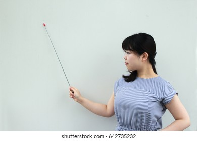 A Japanese woman who presents with an instruction stick, image of business