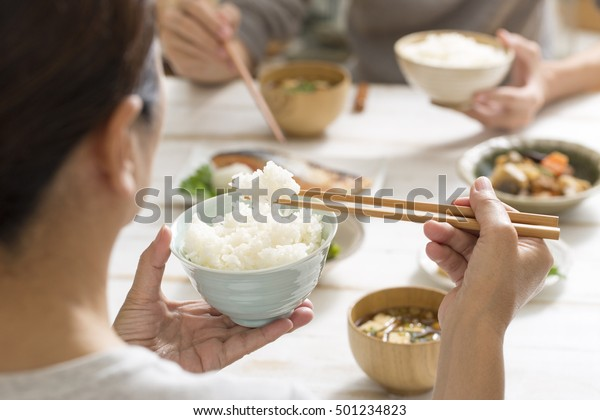 Japanese women eat rice
