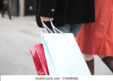Japanese women holding shopping baga