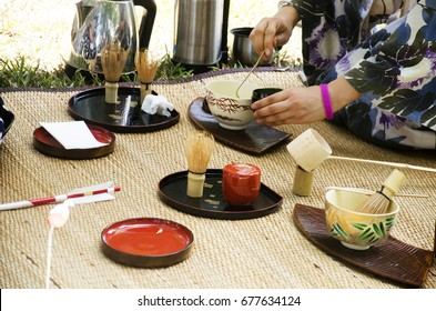 Japanese women making sado chanoyu or Japanese tea ceremony, also called the Way of tea at outdoor in Nakhon Ratchasima, Thailand