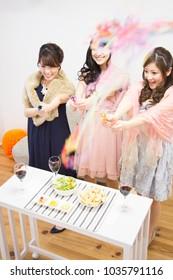 Japanese women play a cracker