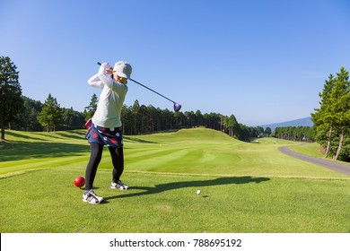 Japanese women playing at the fresh green golf course