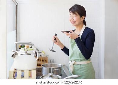 Japanese women tasting dishes