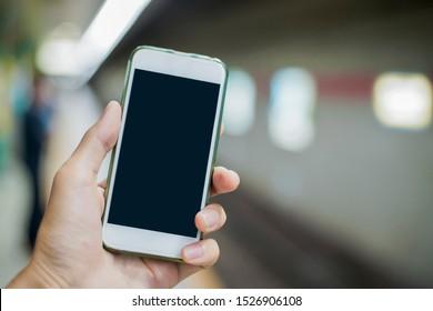 Japanese women use smart on station platform