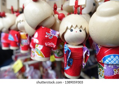 Japanese wooden doll, famous souvenir sold at Asakusa Sensoji Temple.