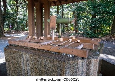 Charming Japanese Wooden Ladle And Fountain Inside Shrine. Tokyo, Japan.