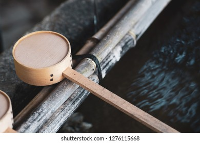 Japanese wooden ladle in shrine or temple in Japan.