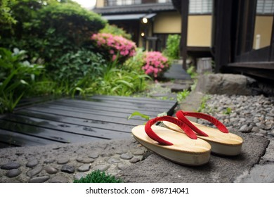 Japanese wooden shoes (geta) by the path of a Japanese ryokan