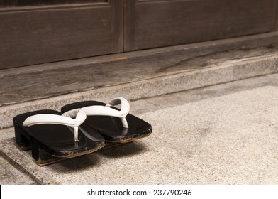Japanese wooden traditional shoes in front of home entrance