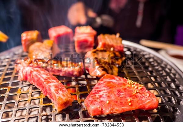 Japanese Yakiniku; Japanese-style bbq. Pork neck yakiniku, Wagyu beef bbq. family dinner in hokkaido, Japan.