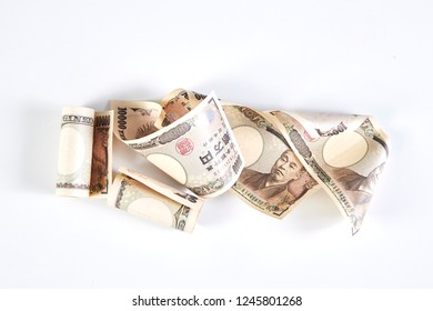 Japanese yen banknotes and Japanese yen coin on white background
