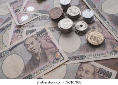 Japanese yen, Japanese currency bank notes and coins on table