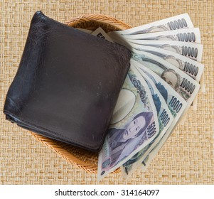 Japanese Yen money or bank notes with an old leather wallet