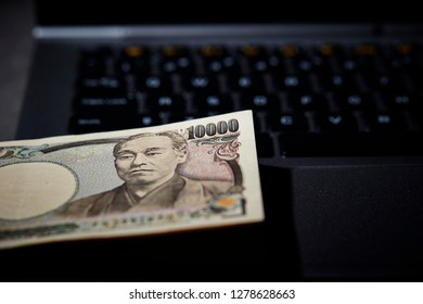 Japanese yen on laptop keyboard