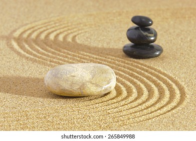Japanese ZEN garden with Feng shui in sand with stones