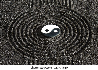 Japanese ZEN garden with stone of yin and yang  in raked sand