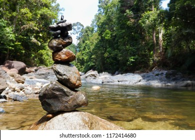 Japanese zen meditation. arrangement of stone for meditation and relaxation at waterfall. harmony and balancing concept.