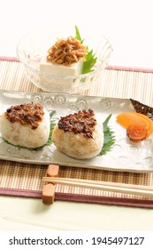 """Japanese-style grilled rice balls with butterbur shoot miso and cold tofu """"Hiyayakko"""""""