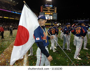 Japan's Ichiro Suzuki celebrates with teammates following their 10-6 win over cuba to win the 2006 World Baseball Classic at Petco Park in San Diego March 20, 2006.
