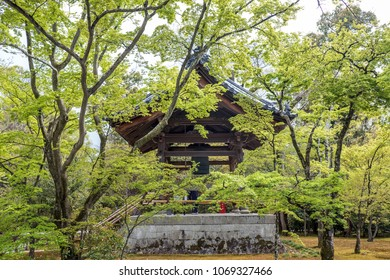 Japnanese buddhism temple bell tower behind tree branches in spring look peaceful