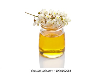 jar of acacia honey on white background - food and drink