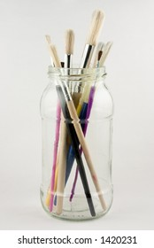 A jar of assorted paint brushes