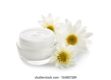Jar with body cream and flowers on white background