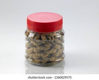 jar of chocolate butter cookies in plastic container on white background