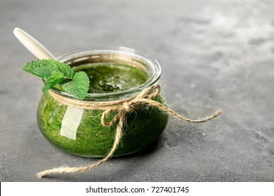 Jar with chutney mint sauce on table