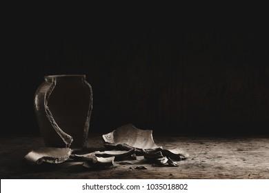 jar Clay pot broken  on dark wooden background