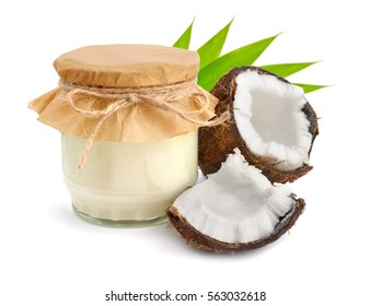 Jar of coconut oil and fresh coconuts isolated