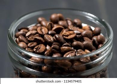 jar of coffee beans, concept photo, closeup horizontal