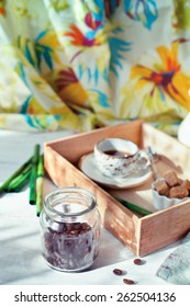 Jar of coffee beans set with a cup of coffee and accessories in colonial style