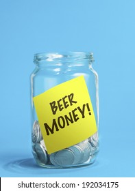 A jar of coins, with beer money reminder note inside the jar.