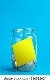 A jar of coins, with blank note. Clipping path included for your own artwork to be placed in