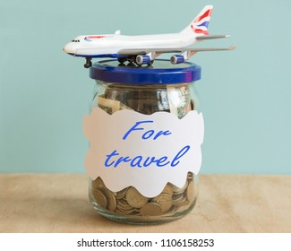 Jar with coins and currency. Save money for travel concepts. Adventures invest.Creative idea to invest currence for travelling.