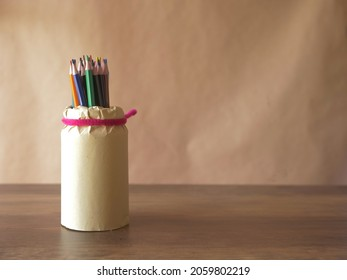 Jar of colorful drawing pencils on background medium shot selective focus