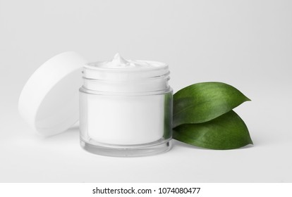 Jar of cosmetic product on light background